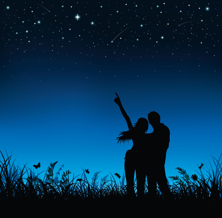 Photo for Silhouette of couple standing and watching the night sky. - Royalty Free Image