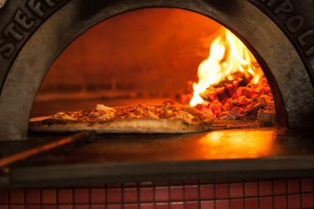 Photo pour Pizza baking close up in the oven - image libre de droit
