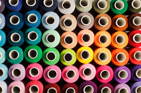 Foto de Sewing threads as a multicolored background close up - Imagen libre de derechos