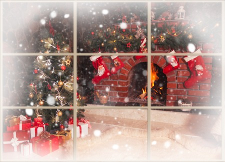 Photo for Christmas decorated fireplace and tree in the room - view throw the window, outdoor - Royalty Free Image