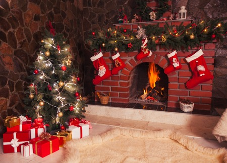 Photo for Christmas decorated fireplace and tree in the room - Royalty Free Image