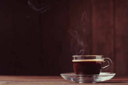 Photo for Cup of coffee with fume on the wooden background - Royalty Free Image