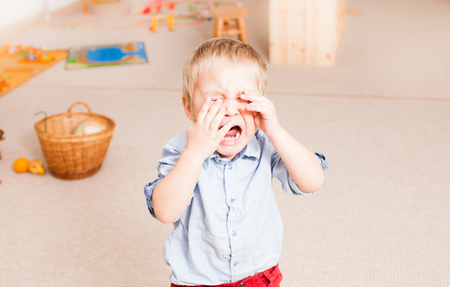 Photo for crying little boy in the kindergarten - Royalty Free Image