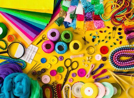 Foto de Craft and hobby materials top view on the yellow background. DIY objects flat lay - Imagen libre de derechos