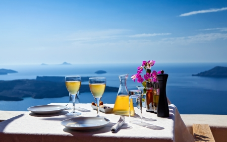 Photo for Table above sea for two  Greece, Santorini island - Royalty Free Image