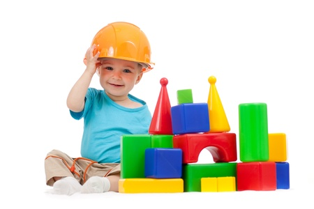 Foto de little boy with hard hat and building blocks - Imagen libre de derechos