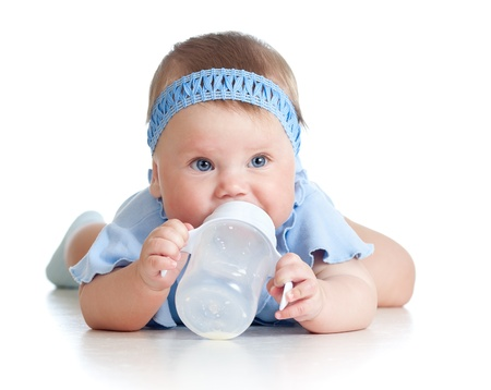 Photo for Pretty baby girl drinking milk from bottle  8 months old  - Royalty Free Image