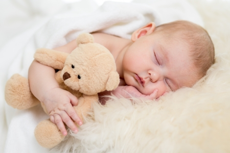 Photo for newborn baby sleeping on fur bed - Royalty Free Image