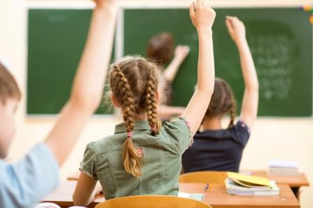 Photo pour Schoolchildren in classroom at lesson - image libre de droit