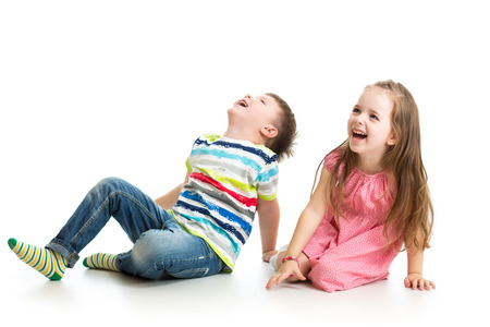 Photo for kids boy and girl showing something up - Royalty Free Image