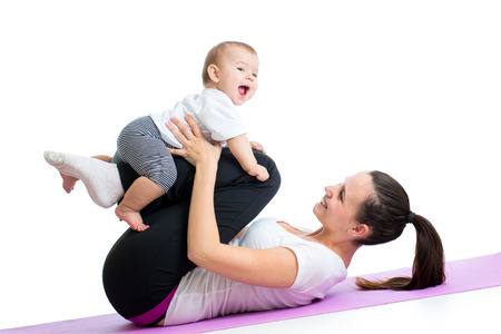 mom with child do gymnastic and fitness exercises