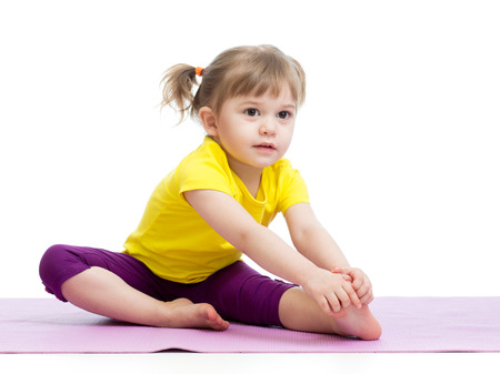 Photo pour Kid girl doing fitness exercises - image libre de droit