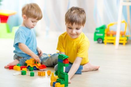 Foto de children boys playing in  playschool or at home - Imagen libre de derechos