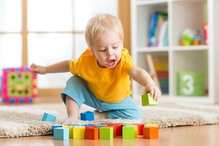 Photo pour kid toddler playing  wooden toys at home or nursery - image libre de droit