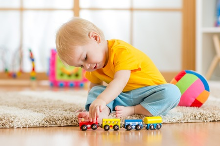 Foto de child boy playing with toys indoors at home - Imagen libre de derechos