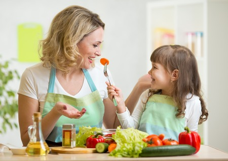 Photo for kid and mother eating healthy food vegetables - Royalty Free Image