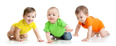 Photo for funny smiling babies toddlers crawling isolated on white - Royalty Free Image
