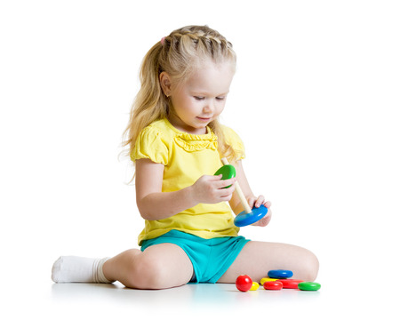 Photo for cute kid playing with color pyramid toy - Royalty Free Image
