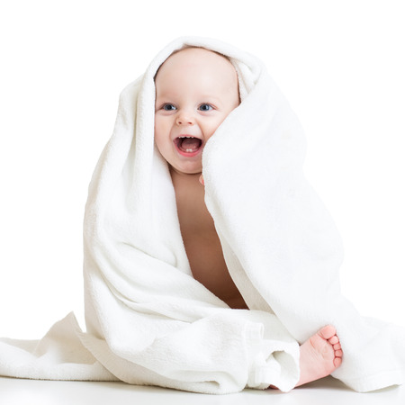 Photo pour Adorable happy baby boy in bathing towel - image libre de droit