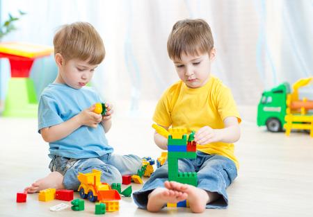 Foto de children play in nursery - Imagen libre de derechos