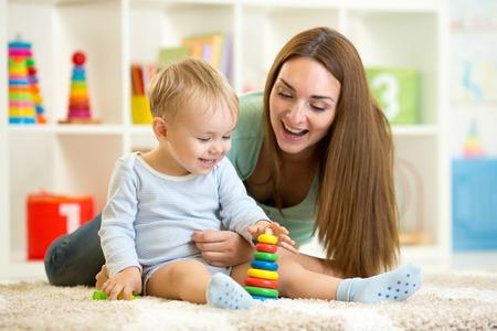 Foto für little child boy and his mommy play with toys at home - Lizenzfreies Bild