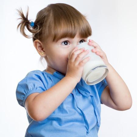 Photo pour Kid Girl drinking milk or yogurt from glass - image libre de droit
