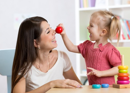 Photo for Smiling mother and little daughter in the nursery, happy time and togetherness - Royalty Free Image