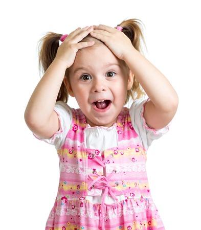 Foto de Amazed or surprised child kid hands holding head isolated - Imagen libre de derechos