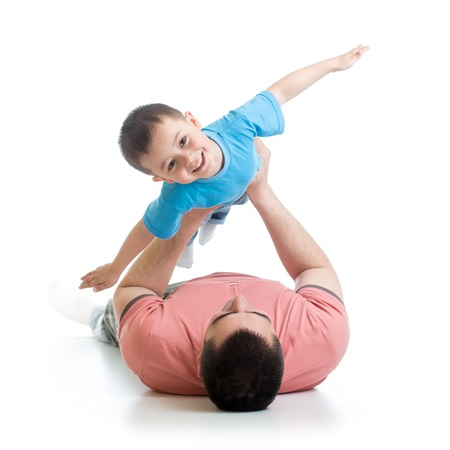 Photo pour happy father playing with son kid lying on floor - image libre de droit
