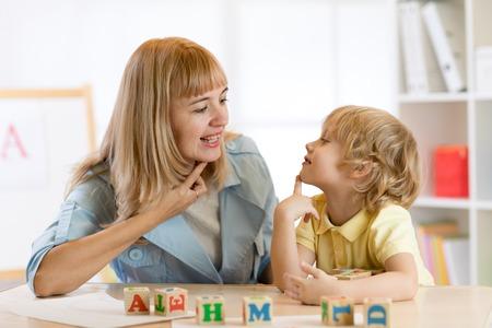 Foto de Woman teacher and little boy on private lesson - Imagen libre de derechos