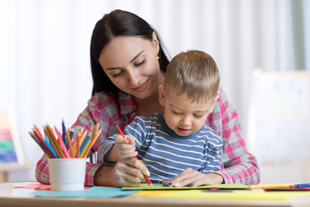 Photo for Mother and child son drawing with colored pencils - Royalty Free Image
