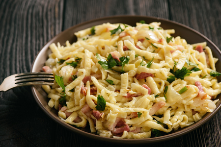 Foto de Spaetzle with bacon and onion, german style cuisine - Imagen libre de derechos