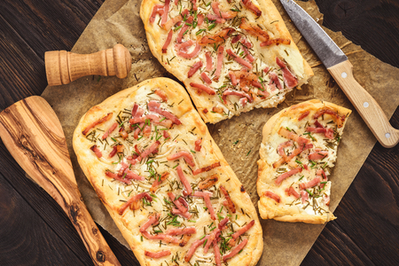Photo for Tarte flambee, traditional alsatian pizza. - Royalty Free Image