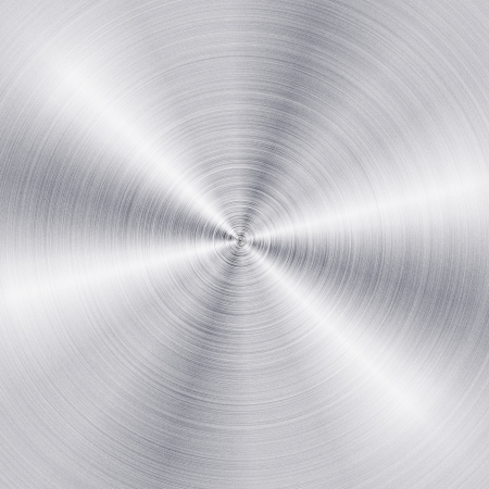 Background of brushed metal plate with reflections in circular shape
