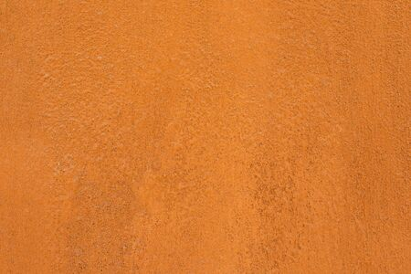 Foto de Traditional moroccan terracotta colored background. Orange or ocher clay wall texture. Painted shabby concrete. - Imagen libre de derechos