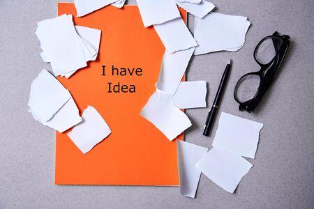 Photo pour Inspiration, insight or good idea concept: torn paper around a blank orange sheet of paper - image libre de droit