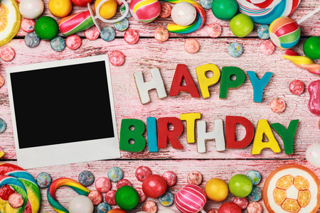 Photo for letters of cookies and happy birthday photo frame - Royalty Free Image