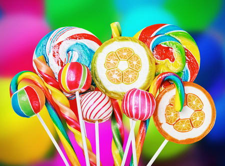 Photo pour Colorful candies and sweets in the background of balloons - image libre de droit