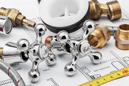 Foto de plumbing and tools lying on drawing for repair - Imagen libre de derechos