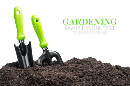 Photo pour garden tools in soil isolated on white background. The text is an example and can be easily removed - image libre de droit