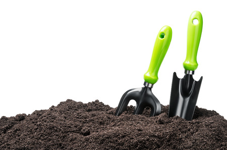 Photo for garden tools in soil isolated on white background - Royalty Free Image