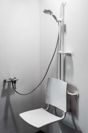 Foto de shower with seat and grab bars for disabled and elderly people in the bathroom - Imagen libre de derechos