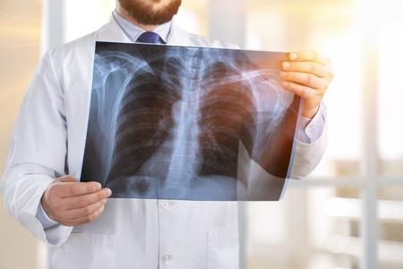 Photo pour Doctor looking at x-ray. - image libre de droit