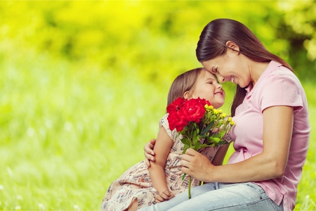 Photo for Woman and child with bouquet of flowers. - Royalty Free Image