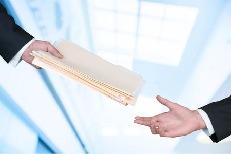 Foto de Hand giving documents. - Imagen libre de derechos