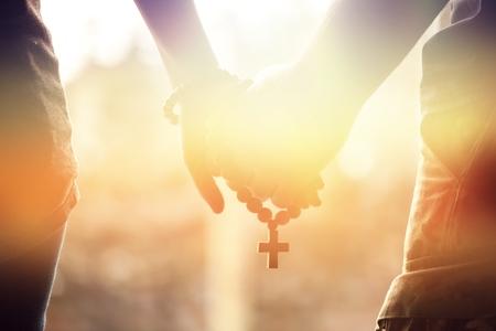 Photo pour Holding rosary in hand. - image libre de droit
