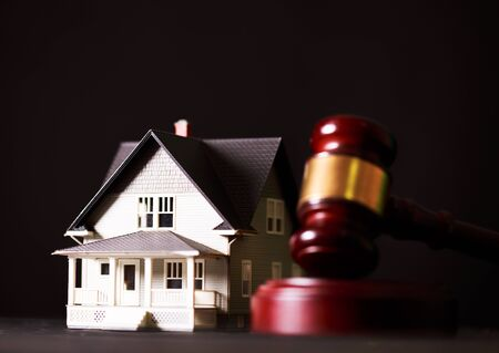Foto de Sign Home, Door Key, Judges Or Auctioneer Gavel And Old Law Book On The Wood Table. Concept For Trial, Bankruptcy, Tax, Mortgage,  Auction Bidding, Foreclosure Or Inherit Real Estate - Imagen libre de derechos