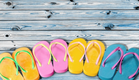 Photo for Rubber sandals flip flops on wooden background - Royalty Free Image