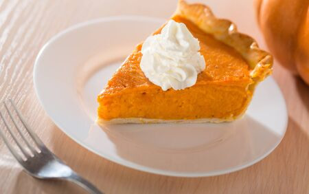 Photo for Pumpkin Pie Slice With Fork - Royalty Free Image
