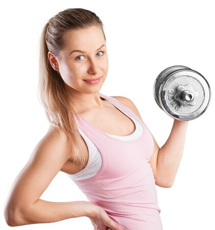 Photo pour Young attractive Woman exercising with dumbbell - image libre de droit